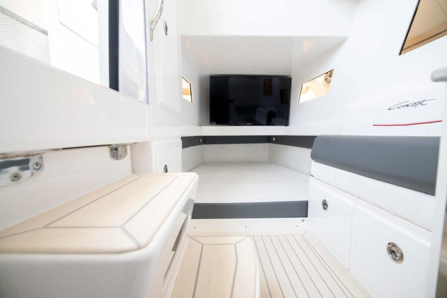 Spacious Interior: <p>The Open Deck has comfortable accommodations below deck under the console to shelter your crew from the elements. </p>